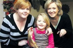 Hair's looking at you kid: Stephanie shows off the hair she had cut off in aid of the Rapunzel charity with Mum Deborah, left, and hairdresser Denise Tully of Deja Vu salon in Cavan. Photo: Lorraine Teevan