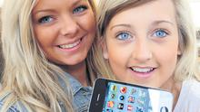 Gemma McCord and Lori Smith with their iPhone 4G which went on sale in Belfast yesterday for the first time