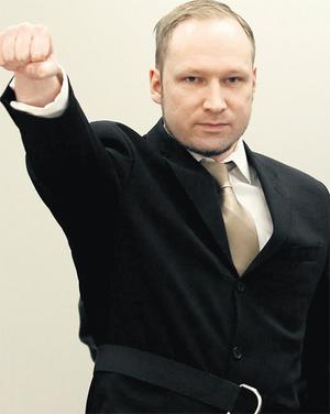 Anders Behring Breivik gives a Nazi-style salute as he arrives in court for the first day of his mass murder trial yesterday. Photo: Reuters