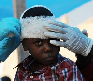 A young boy receives medical aid in a tent hospital in the Haitian capital Port-au-Prince. Photo: Getty Images