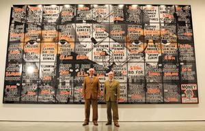 Artists Gilbert Proesch (right) and George Passmore (left) with artworks from their 'London Pictures' series,