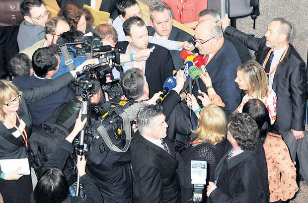 Phil Hogan is mobbed by media as he arrives at the ard fheis in Dublin.