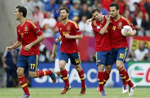 Spain's Cesc Fabregas, right, celebrates with teammates after scoring during the Group C match between Spain and Italy in Gdansk. Photo: AP