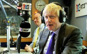 The Mayor of London Boris Johnson (right) gives a reply to a question from a listener, as Ken Livingstone looks on. Photo: PA
