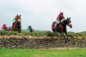 Another Jewel and John Cullen (L) jump the stone wall behind eventual runner-up Let The Show Begin (R) on the way to landing the La Touche Cup