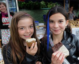 Natalie Vaireaux and Clara Weldon, from Dingle, enjoying cupcakes at the festival