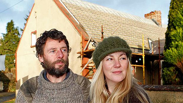 Ian and Helen Holyoak outside the home they are renovating