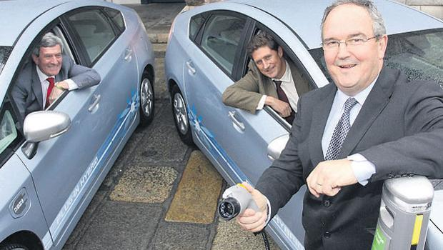 UNPLUGGED: ESB chief executive Padraig McManus (left), Energy Minister Eamon Ryan, and David Shannon, managing director of Toyota Ireland at the introduction of the new Plug-in Prius Hybrid vehicles (PHV) to Ireland