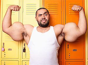 Egyptian-born Moustafa Ismail, recognised for having the largest biceps and triceps, with a circumference of 25.5in