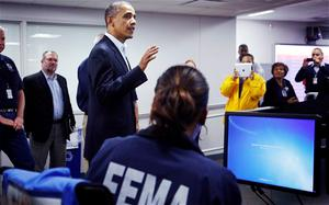 US President Barack Obama visited the headquarters of the FEMA for an update and urged Americans to 'pull together' Photo: Reuters