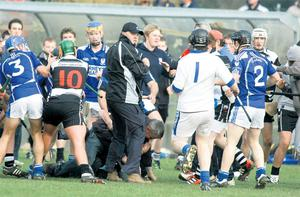 Clare hurling legend Anthony Daly and Stephen Sheedy of Clarecastle are shown involved in a fight with Kilmaley's Niall Romer during the Clare minor hurling final at Sixmilebridge, Co Clare
