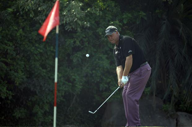 Darren Clarke chips during the Final Round of the Avantha Masters Photo: Getty Images