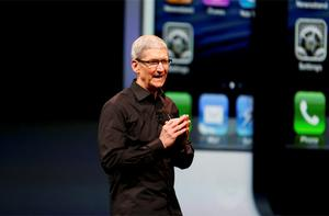 Apple Inc. CEO Tim Cook takes the stage after the introduction of the iPhone 5