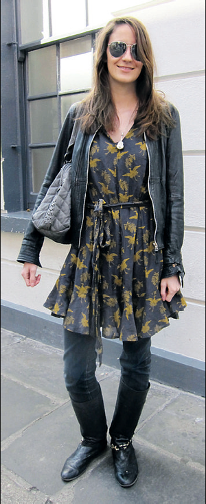 Lisa gives her printed dress a street-chic edge by layering with leather and denim