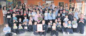 Local author Mary O'Sullivan presented 1,000 Euro, a percentage of the proceeds from the sale of her book 'How it was' to Derrinagree National School. Mary is pictured with pupils, school principal Aindrias O'Sullivan, Cathy Walsh, Cathriona O'Shea,... Credit: Photo by Sheila Fitzgerald