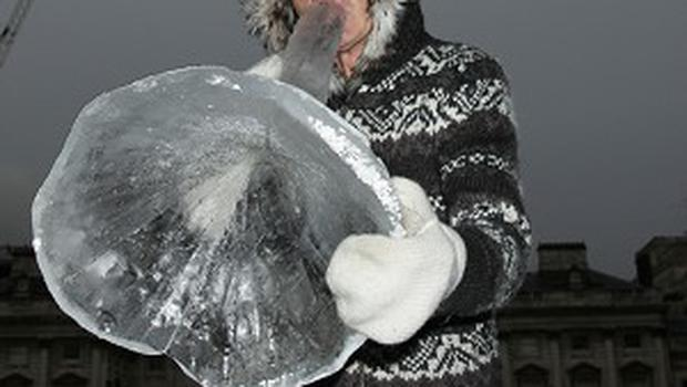 Terje Isungset plays an ice horn during a preview of Ice Music at Somerset House