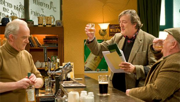 Actor Stephen Fry raises a glass during filming of his cameo in the TG4 show 'Ros na Run'