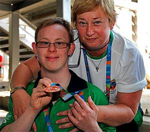 Peter Oxley from Tyrrellspass, Co Westmeath, won a bronze medal in the men's 100m backstroke final. Pictured with Peter is his coach Teresa McCabe