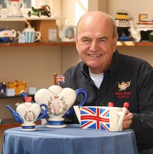 Tony Carter with the themed teapots that celebrate the Queen's Diamond Jubilee