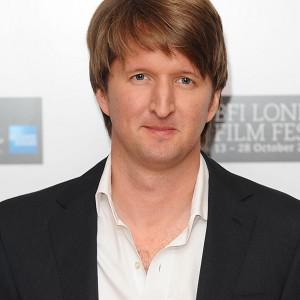 Tom Hooper has pulled off an upset win for the top film honour at the Directors Guild of America awards for The King's Speech