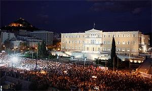 The scene in Athens yesterday where thousands converged on the Greek parliament to protest  over the government's plans for new austerity measures
