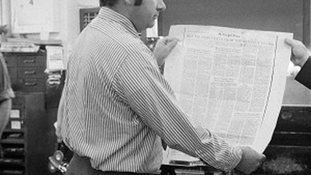 June 30, 1971 and staff at the New York Times look at a proof sheet of a page containing the secret Pentagon report on Vietnam(AP)