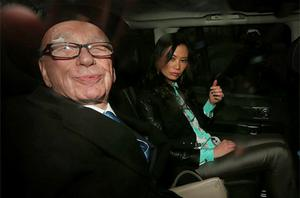 Rupert Murdoch leaves The Royal Courts of Justice with his wife Wendi Deng Murdoch after giving evidence to The leveson Inquiry. Photo: Getty Images