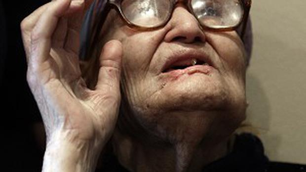 Warina Zaya Bashou, 111, recites the oath of allegiance during her ceremony to become a US citizen (AP/Paul Sancya)