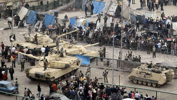 CHAOS: Egyptian tanks separate pro-government and anti-government protesters in Tahrir Square, Cairo, last week. Photo: Lefteris Pitarakis/AP