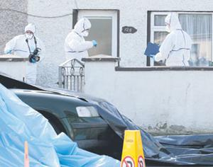 Members of the Garda Crime Scene Investigation Unit at the house on Kilbride Street in Tullamore where one man was fatally stabbed and another was injured yesterday