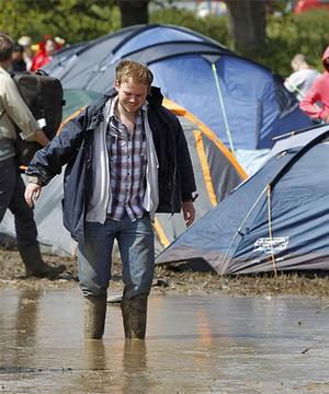 Mud and water at the campsite at the Isle of Wight festival. Photo: PA