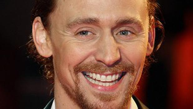 Tom Hiddleston arrives for the UK film premiere of War Horse at the Odeon West End, London