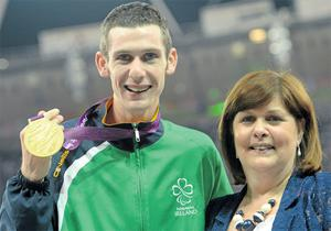 Michael McKillop from Newtownabbey celebrates with mum Catherine after she presented him with his gold medal