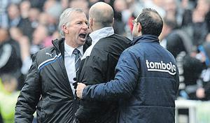 Alan Pardew and Martin O'Neill are kept apart by Lee Mason as tempers reach boiling point