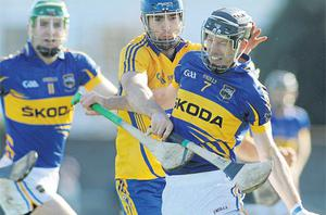 Tipperary's Shane Maher tries to get away from Clare's Camin Morey at O'Garney Park, Sixmilebridge, yesterday