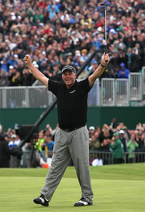 Clarke celebrates after sinking his putt on the 18th to win the 2011 Open Chapionship. Photo: PA