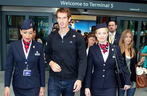 US Open winner Andy Murray and his girlfriend Kim Sears (right) arrive back at Terminal 5 at Heathrow Airport