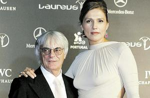 No tall tale: This biography paints a picture of Bernie Ecclestone, pictured  with wife Slavica, as secretive and obsessive compulsive