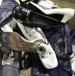 Shoes once worn by ex-Philippine first lady Imelda Marcos at the National Museum in Manila have been damaged (AP)