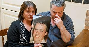 James's parents, Essie and Jimmy Nolan, with a picture of their son