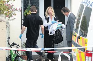 Gardai remove blankets and bottles from the home of PJ Duffy