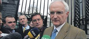 We're not there yet: John Gormley and Dan Boyle meet the press yesterday after their continuing talks with FF on forming a government
