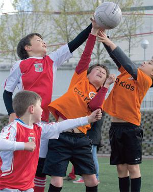 Children playing under-12 Gaelic football match in the town of Tres Cantos, on the outskirts of Madrid.