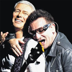 U2's Adam Clayton and Bono on stage during their '360' tour at the Olympic stadium in Turin, Italy, in 2010