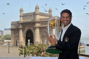 India's Sachin Tendulkar poses with the World Cup trophy in front of the famous Gateway of India monument yesterday. Photo: Getty Images