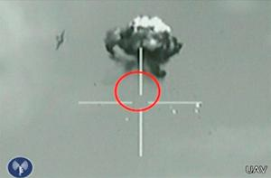 A still image taken from Israeli Defence Forces (IDF) video footage shows what they say is a small unidentified aircraft shot down in a mid-air interception after it crossed into southern Israel