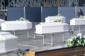 Coffins of the victims at Melsbroek Military Airport in Belgium yesterday