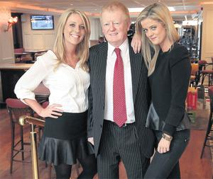 Publican Charlie Chawke with his daughters Ali (left) and Jenny at Searsons