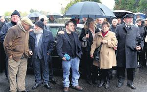 Family members at Barney McKenna's funeral in Trim, Co Meath, yesterday, including his sister Maria (in beige coat) and his brother Sean Og McKenna (third from left in woollen hat)