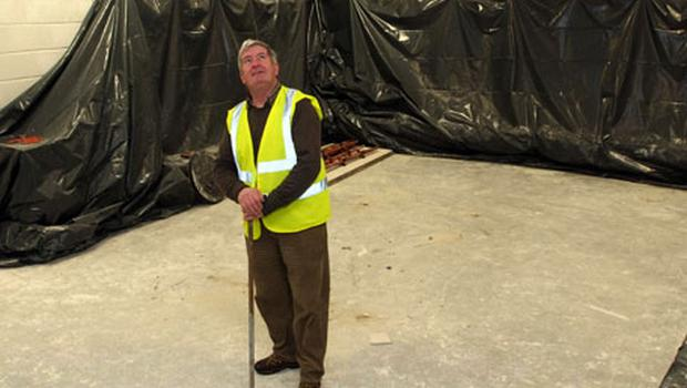 John Lenihan, the caretaker at Fitzgerald Stadium, Killarney in one of the dressing rooms which was extensively damaged when the roof collapsed from burst pipes last week. Photo: Don MacMonagle